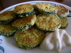 The first time I had fried zucchini, I was little and my mother made it. (You know how good of a cook she proclaims to be - awful. Pan Fried Zucchini, Fried Zucchini Recipes, Zucchini Fries, Veggie Recipes, Great Recipes, Snack Recipes, Cooking Recipes, Favorite Recipes, Snacks