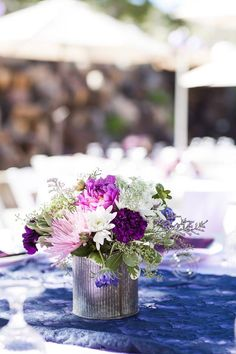 A mix of purples with navy blue accent on the table