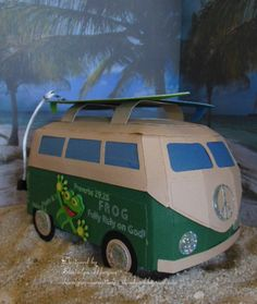 This is a German look a like Bus I made for our Youth Pastor At Church. I used the Surf Shack Kit from SVG cuts (note leash and rack was my own creation) Frog not included as well .