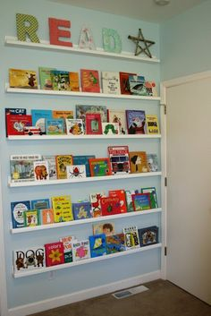 Cute idea (on a smaller scale) for the classroom... maybe a *students choice* book wall each month. :)