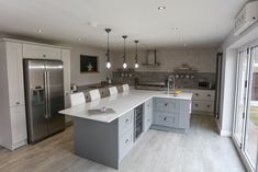 We are having serious kitchen envy over our recent design in two shades of grey within this large extension. The majority of the kitchen units are in the paler grey of Platinum with the island featured in Cobble Grey with Cromwell cup handles and knobs by Hafele. The worktops are Silestone in White Storm & Kensho. The American Style Fridge Freezer by NEFF is supersized and perfect for family life as too is the Range by SMEG. The large island is also suited to this busy , family home. Shaker Kitchen, Kitchen Units, New Kitchen, Kitchen Dining, Kitchen Ideas, Dining Room, American Fridge Freezers, American Style Fridge Freezer, House Color Schemes