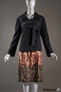 Ensemble | Dries Van Noten (Belgian, b. 1958) | Black rayon, cotton, wool and moiré, tan linen, red velvet, brown mesh, and brown leather | Belgium, Fall 2006 | Museum at FIT