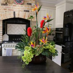 A beautiful Demmerys artificial flower arrangement can make all the difference to the ambiance within any room, giving a vibrant and energetic mood that fills the whole room with colour and life! Tropical Flower Arrangements, Flower Arrangement Designs, Artificial Flower Arrangements, Silk Flower Arrangements, Large Artificial Flowers, Artificial Silk Flowers, Exotic Flowers, Tropical Flowers, Orchid Plants