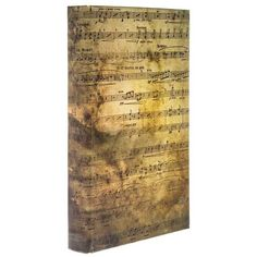Take organization to a whole new level with this Sheet Music Lined Book Box! This lovely book box features a vintage finish with printed sheet music and a plush