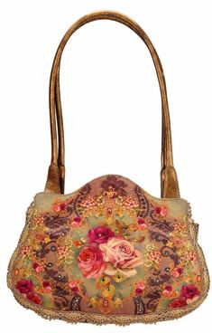 Michal Negrin hand-printed velvet bag. 3 Convenient inside pockets and key holder Hand crafted in Israel using Swarovski crystals. Height 21 cm Width 27 cm