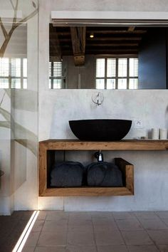 This is awesome shelving for the sink area but still so simple! Hampers for dirty laundry underneath