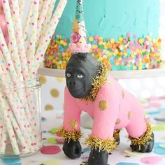 Love this girly animal parade party!! Fun mix of the pink and gold Gorilla cake topper by Painted Parade on Etsy