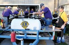 Members of the Sterling Lions Club were hard at work preparing pancakes, sausage and eggs, at the club's annual Cowboy Breakfast Wedne...