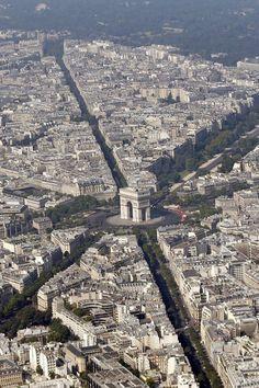 An aerial view shows the Arc de Triomphe and rooftops of residential buildings in Parisin Paris. Paris Vu Du Ciel, Paris France, Architecture Parisienne, Belle France, Paris City, Paris Jackson, Tour Eiffel, France Travel, Paris Hilton