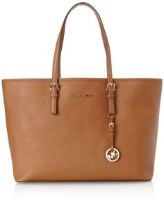 Multifunction Saffiano Travel Tote- Medium Jet Set Multifunction Saffiano Travel Tote in Coffee by Michael Kors. Luggage saffiano leather. Goldtone color hardware. Buckled shoulder straps; 8 1/2-in drop. Hanging MK circle logo charm. Michael Kors logo on top center. Inside, center zip compartment; one zip and three open pockets.