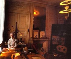 Eileen Gray in her apartment. Notice the hanging light? Yves Saint Laurent had it in his personal collection upon Gray's death.
