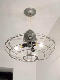 Repurposed fan cage / ceiling fixture (www.tomtinc.com)