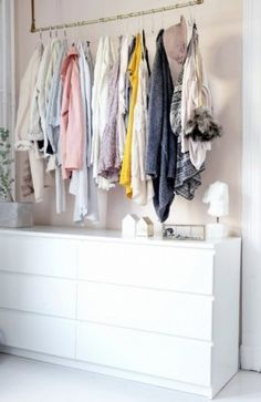 were-charmed-by-the-delicate-approachable-simplicity-of-this-sweet-space-unassuming-drawers-store-foldable-clothes-while-a-brass-rod-suspended-by-leather-straps-is-the-perfect-place-to-display-hanging.jpg (287×442)