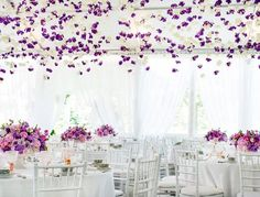 Wedding Flowers Ideas Sweet Purple Wedding Flowers Design On The White Round Wedding Dining Table Matched With Elegant White Dining Chairs Beautify the wedding Party Decoration By Applying Beautiful Wedding Flowers Wedding Reception Design, Wedding Flower Design, Wedding Designs, Wedding Table, Lilac Wedding, Purple Wedding Flowers, Mod Wedding, Deco Violet, Wedding Planners In Mumbai