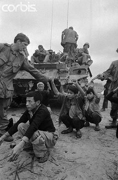 https://flic.kr/p/6F2VBY | U1584414 | 22 Feb 1968, Hue, South Vietnam --- Viet Cong suspects are guarded by 1st Cavalry Division soldiers on a road north of Hue in this photo. The U.S. troops were marching to relieve Marines attacking the then Communist-held Citadel in Hue. The Citadel fell to allied forces on February 24th. --- Image by © Bettmann/CORBIS