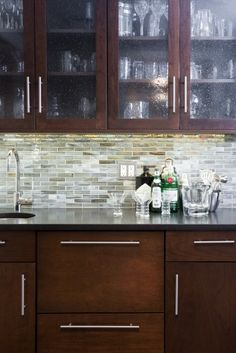 Anne- I like this backsplash for all of the same reasons as the other, but I prefer this shape. It's a little more modern and woud trick the eye to emphasize the width of the kitchen, making it feel bigger and tying the dining room into the space.