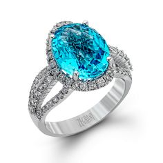 A gorgeous single 6.14ct Blue Topaz captures the attention of anyone looking in this Blindingly Beautiful Collection ring made of 14K white gold and complimented by .81ctw of white diamonds.