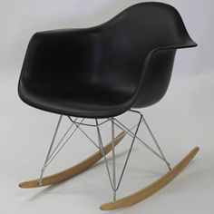@Overstock - Not Grandma's rocking chair, this mid-century retro modern rocker has an avant-garde style with pizzazz. Still a comfortable seat for lulling children to sleep or moving in time to music, this rocking chair is a symbol of the modern home.http://www.overstock.com/Home-Garden/Black-Molded-Plastic-Armchair-Rocker/6672984/product.html?CID=214117 $149.99