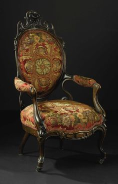 An American Rococo Revival Carved Rosewood Arm Chair. In The Manner Of John  Henry Belter