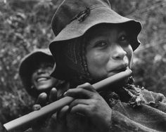 Andean boy playing a flute, Peru, 1956 by Eugene Harris