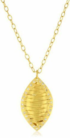 """Kevia """"Etrusca"""" Cubic Zirconia Edged Woven Diamond Shape Pendant Necklace kevia. $115.00. Crafted with strips of hand woven foiled metal. White cubic zirconia stones set at edges add sparkle. Made in India. Finished with a matte 22K gold plating"""