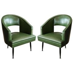 Pair Of Barrel Tub Chairs With Cutout Backs And Metal Legs | From a unique collection of antique and modern armchairs at http://www.1stdibs.com/furniture/seating/armchairs/