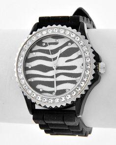 Rhodiumized / Clear Rhinestone / Black Rubber / Buckle Closure / Zebra Print / Band Watch