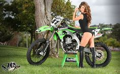 Model Crissy Lynn and a Kawasaki dirt bike.