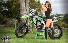 Model Crissy Lynn and a Kawasaki dirt bike.