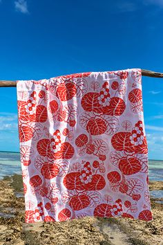 Beach towel (sea grapes) in coral by Bahama Hand Prints