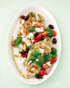 It's easy to get dinner on the table quickly if you pick one aspect of the meal to make simply. Here, we've assembled a knockout relish of mint, olives, tomatoes, and feta -- and used it to top an easy grilled chicken breast.