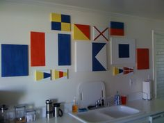 DIY Nautical flag designs painted on canvas.