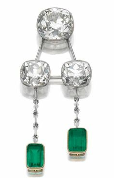EMERALD AND DIAMOND PENDENT NECKLACE The front set with three millegrain collet-set cushion-shaped diamonds, connected by knife-edge linking, suspending two step-cut emeralds, to a fine link chain, length approximately 330mm.