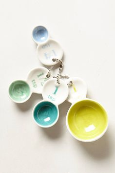 Color Tab Measuring Spoons - anthropologie.com. Makes me want to bake right now!