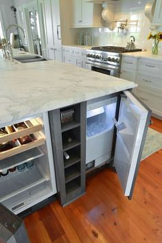 kitchen island with a fridge and a cooler