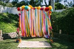 colorful giant pompoms and ribbons for photobooth