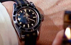 "The elusive Bond Rolex Submariner (6538, 5510?) on an undersized British regimental NATO-style strap (Black/Burgundy/Olive) - as worn by Sean Connery in ""Goldfinger"""