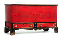 """DECORATED BLANKET CHEST, Peter K. Thomas, Soap Hollow, Pennsylvania, dated 1862, poplar. Dovetailed case over two drawers, interior till, and on bracket feet. Retains its original stenciled decoration, including """"CB 1862"""" and """"Manufactured by Peter K. Thomas,"""" on a red ground, trimmed in black and yellow."""