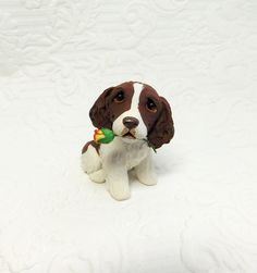 Spinger Spaniel lover Gift, English Springer Spaniel art, Springer Spaniel Sculpture Polymer Clay with Rose Mini by Raquel at theWRC. Spinger Spaniel lover Gift, English Springer Spaniel art, Springer Spaniel Sculpture Polymer Clay with Rose Mini by Raquel at theWRC This little pup looks so cute holding a a rose in it's mouth for someone special! Hand sculpted polymer clay dog. Made with love and care! Measures approx. 2.25 inches tall.