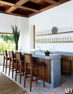 At the Mexico vacation home of actor George Clooney, the bar area features locally crafted stools.