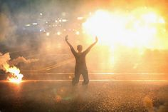 This woman in Ferguson, Missouri, demonstrating on her knees amid a cloud of tear gas in 2014.