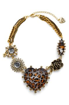 Most heart-themed jewelry is too precious for me.  But this, I love.  Betsey Johnson Leopard Heart Collar Necklace, Nordstrom Exclusive.  $125 on sale for $79.90