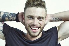 "Gus Kenworthy on when he couldn't check into same hotel room as boyfriend in Russia. 'They were like, ""Two guys can't be in the same bed""'"