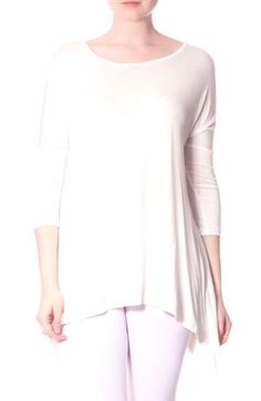 This solid ivory 3/4 sleeve loose fit tunic has a high low hem with the long part on the sides. It is made of rayon which will not shrink.  It is very lightweight!