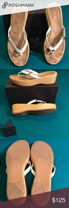 Authentic Prada thong shoe 40 Prada shoe. Size 40. USA 10. Made in Italy. Slight wear. EUC. Bought at Neiman Marcus. White leather silver hardware no tears in platforms. Comes with Prada card and box. 💯 authentic.   🚫No trades ✅ Reasonable offers considered  🚭 Smoke free home Prada Shoes Sandals