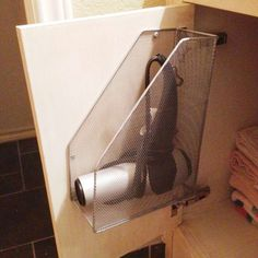 ...Or, screw a magazine rack inside your bathroom cabinet to keep it out of sight. - Kathleen Kamphausen