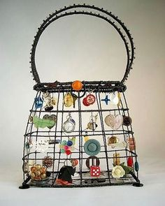"679 Likes, 16 Comments - Carole Tanenbaum (@caroletanenbaum) on Instagram: ""Kosnuma Tzakis.  #handbag #playful #dada #charms #fun #originaldesign #creative #kosnumatzakis"""