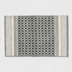 A Woven Diamond Gray Accent Rug from Threshold™ will make a flexible addition to your decor that you can place almost anywhere. This accent rug features both striped and geometric patterns, all in a neutral color scheme that can easily blend with your other decor. This rug looks especially nice on stone or polished concrete, as well as with Scandinavian decor.<br><br>GoodWeave's goal is to combat child labor in the handwoven-goods industry, support adult artisans and provide educat...