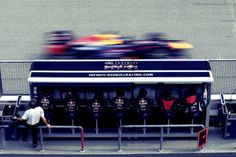 Vettel going past the Redbull pit wall during the 2013 Malaysian F1 GP