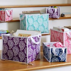 A bright paisley print adds a little punch to these collapsible bins. Made of cotton canvas with durable side handles and a removable base.